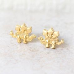 ★★Description★★    Tiny cute dinosaur - stegosaurus earrings. Size: the measurement is approx. 13 x 10 mm **plated brass, surgical steel posts**    Look