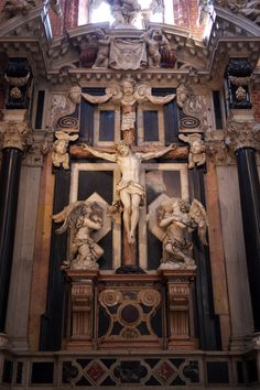 Altar of the Crucifixion at the Basilica Minore di Santa Maria Gloriosa dei Frari, San Polo district, Venice, Italy. Considered one of the greatest churches in Venice, it is a treasure trove of some Venetian art; Titian, one of Venice's most important painters, is interred in it.