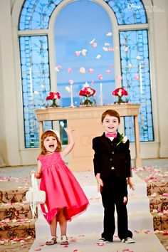 This flower girl and ring bearer know how to celebrate a happily ever after! #wedding #photography #Disney #WeddingPavilion