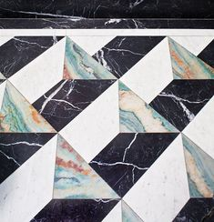 3D effect marble tiles, one way to make a bold geometric statement #marble tile shower #marbleflooring #marblebathroom