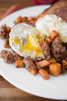 Autumn Sweet Potato Hash with Spicy Italian Sausage, Caramelized Onions and Asiago Cheese