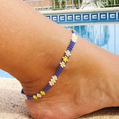 This White and yellow Daisy ankle bracelet is beaded with tiny Cobalt blue lustre seed beads, and ac Seed Bead Bracelets, Seed Beads, Beach Anklets, Handmade Beaded Jewelry, Handmade Bracelets, Anklet Bracelet, Daisy Chain, Sterling Silver Bracelets, Turquoise