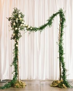 A lush strand of garland drew the crowd's focus to the front of the room during the ceremony. Check out more of this real wedding in South Carolina