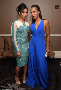 Celebration time: Kerry ran into actress Regina Hall backstage...