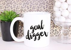 GOAL DIGGER COFFEE MUG  Coffee & productivity go hand in hand… at least in our studio so we're betting that you work the same! Get a hold of