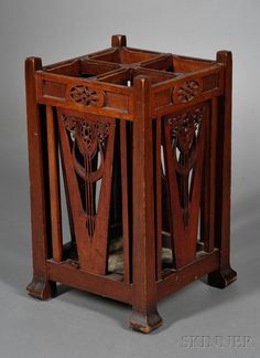 Art Nouveau Umbrella Stand Mahogany United States, c. 1913 Four pierced and decorated sides in the Art Nouveau manner, fitted with four compartments with umbrella pan, partially legible inscription in pencil dates this piece to 1913, Jamaica Plain, ht. 24 3/8, dia. 14 1/8 in. Sold for $490.