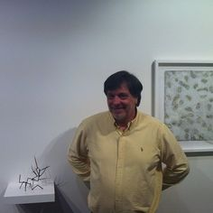 Leslie Oliver at Thursday's opening, standing with two works he made in collaboration with Melinda Le Guay #InTandem