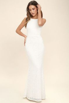 Lulus Exclusive! Everyone will want to catch a glimpse of you in the Ephemeral Allure Ivory Lace Maxi Dress! Lovely floral lace descends from an apron neckline (with spaghetti straps) into a darted, fitted bodice. Sexy open back tops a flaring mermaid maxi skirt. Hidden back zipper/clasp.