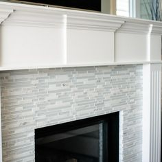 Updated fireplace. Grey & black glass tile. #decor #tile ...