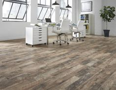 If uncommon style is what you crave, Calico Oak laminate gratifies with flair. Rooted in nature, the authentic look of time-worn wood features varying weathered hues that fill a room with rustic, casual charm. v