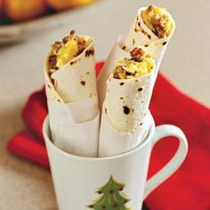 "Try this ""Breakfast Tortillas""- Prep: 5 min., Bake: 10 min., Cook: 13 min. Wrap these individually in parchment paper or foil for a portable breakfast.. your family & friend's will like it."