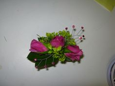 pink roses with green hydrangea corsage