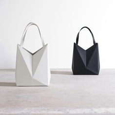 Vox tote stands on its own and folds flat for storing! Shown here in bone and black leather. #tote #shopping #fold #origami #design…