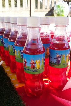 Red Cooldrink Bottles with Teletubbies Labels