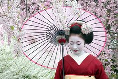 Geisha with umbrella.