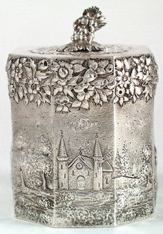 American sterling silver repoussé tea caddy, with ship motif on one side, a church on the end and a figural grape design finial - Peter Krider, Philadelphia c. 1870's (spencermarks) (a)