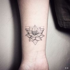 Lotus Flower and Triangle Tattoo on Arm.