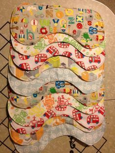 Easy Flannel Burp Cloths Tutorial...designed to curve around your neck when burping baby. Or around baby's neck when feeding to catch drips. Made from flannel.