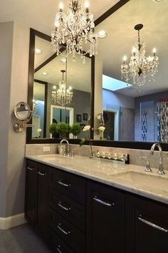 LOVE chandelier!  This would look AWESOME in out Master Bath!!! I want to darken our cabinets & put light marble or granite on top. Frame existing mirrors, VIOLA!