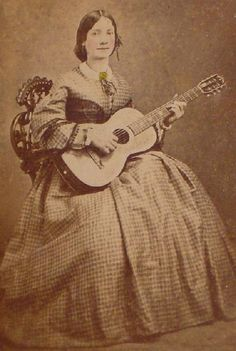 The Barrington House Educational Center, L.L.C.  Woman playing the guitar