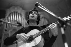 Leonard Cohen performs onstage at the Musikhalle on May 4, 1970, in Hamburg, Germany.