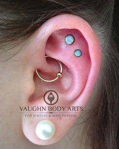 vaughnbodyarts:  Kelly came in yesterday because she liked the pictures we have been posting on Instagram (thank you social media!). She left with two new flat piercings done with Industrial Strength light pink opals anodized copper, and a new daith (my absolute favorite piercing to do) with a 16g 14k solid yellow-gold captive bead ring from Body Vision Los Angeles. Thank you, Kelly!!