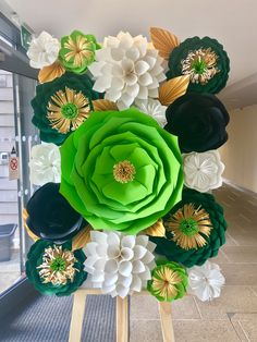 Wild Amazon paper floral sweet table backdrop created by @prettypartyflowers (Instagram + Facebook) Dark and vibrant green, white, black and paper flowers with gold leaves. Great for birthdays, bridal, christening and other special occasions.