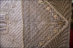 Close up of my damaged linen Petting Zoo quilt.