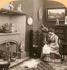 A stereoscope of a woman using a stereoscope, ca 1901. So meta. The entire cabinet to the woman's right is full of stereograph cards.