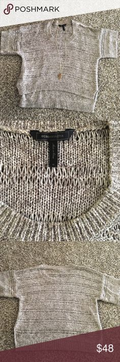 BCBG Knit Sweater BCBG knit sweater in great condition. Only worn a few times and there are no flaws or snags. This sweater is great layers with a tank top underneath. It is short in the front and longer in the back. No trades! BCBG Sweaters Crew & Scoop Necks
