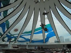 https://flic.kr/p/8RriFn   Catedral Metropolitana Nossa Senhora Aparecida   [en] Cathedral of Brasília from Óscar Niemeyer. Sculptures by Alfredo Ceschiatti and Dante Croce, 1970. @ Brasília, DF, Brasil    [fr] Cathédrale Métropolitaine Notre-Dame de l'Apparition de Brasilia de Óscar Niemeyer. Sculptures by Alfredo Ceschiatti et Dante Croce, 1970. @ Brasília, DF, Brasil    [pt] Catedral Metropolitana Nossa Senhora Aparecida de Óscar Niemeyer. Esculturas de Alfredo Ceschiatti, e Dante Croce…