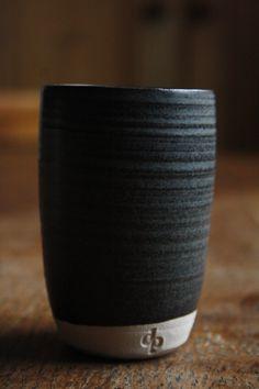 base glaze: 40 Potash Feldspar, 20 Whiting, 25 China Clay and 15 Flint. for black: 4% Nickel Oxide, 4% Red Iron Oxide, 2% Cobalt Carbonate