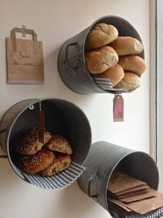 retail display - galvanized buckets for display and storage - bread and wrap.....how to put on wall though....