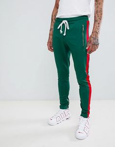 10b8c5021480 Criminal Damage skinny sweatpants in green with red side stripe