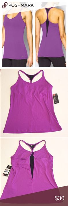 "Under Armour Fitted HeatGear Tank Athletic Workout NWT Racerback tank from Under Armour! The color is more of a raspberry than purple, but lends to the purple hue. Very pretty! The black is a breathable mesh, this tank is perfect for whatever your activity might be. From yoga to running! The last picture is taken directly from the UA website and is their description of this exact top. Also has a built in shelf bra with opening for inserts if needed. 90% Polyester 10% Elastane, 26"" long from…"