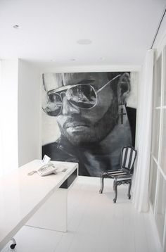 """""""What that wall needs is a George Michael mural. Don't forget the earring."""""""