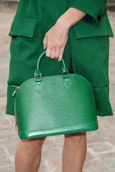 All green affair with this Louis Vuitton Alma in Epi leather.