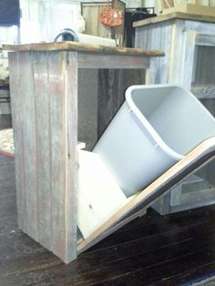 Second picture of Barnwood tip out trash can holder.