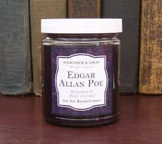 Adorable literary candles for book lovers, including this Edgar Allan Poe candle.