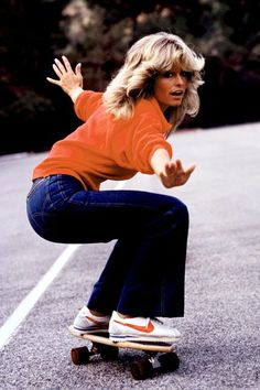 Farrah Fawcett wore her denim at its youthful breezy best and made fitted flared jeans de rigour for all Seventies girls