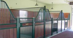 Our Savannah horse stall, made in the European style, features low stall fronts, beautifully curved wings, horizontal wood panels and safety finger latches