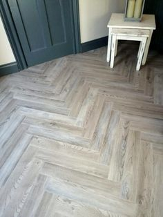 A parquet herringbone laminate with rating. Wood Floors in stock. Grey Laminate, Herringbone Wood Floor, Grey Wood Floors, Herringbone Laminate Flooring, Herringbone Floor, Herringbone Tile, Flooring, Flooring Shops, Vinyl Flooring