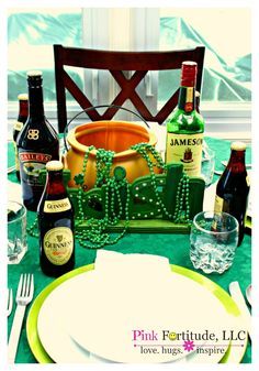Guinness, green, and a pot of gold tablescape for St. Patrick's Day by coconutheadsurvivalguide.com