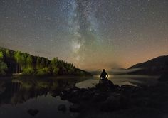 """""""Stargazing in Snowdonia"""" Kris: """"Last shot from a lovely night spent down at Llyn Mymbyr, watching twilight disappear and The Milky Way spring into life above Snowdonia. I sat here for around 3-4 hours while recording a time-lapse, while the fog dipped in and out of the valley over the lake, although I wished the farm at the other end of the lake would switch their outside light off...So for this shot, I plonked myself in-front of it. ;-)""""  Credit: Kris Williams Location: Llynnau Mymbyr…"""