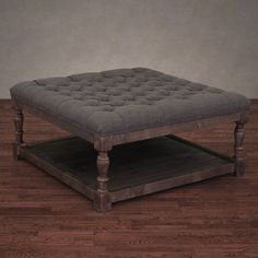This tufted ottoman features comfortable and durable fire retardant foam cushioning coupled with solid wood framing in a reclaimed finish. Soft and smoke linen fabric covers this unique piece of furniture beautifully.