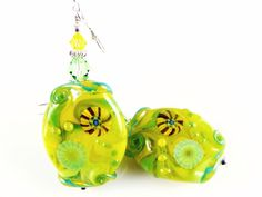 Yellow Glass Bead Earrings, Green Lampwork Earrings, Dangle Earrings, Dangle Drop Earrings, Colorful Abstract Earrings, Lampwork Jewelry #yellowearrings #giftidea #giftformom #artisanearrings #statementearrings #statementjewelry #handmadejewelry #glassbeadearrings #lampworkjewelry #lampworkearrings #earrings #handmadeearrings #modearrings #dropearrings #colorfulearrings