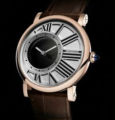 Rotonde de Cartier Mysterious Hours.  A two-hand time-only watch, this novelty is a study in how to dress complexity in apparently a simple dress.