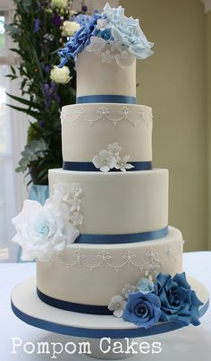 Wedding cake with blue roses by Pompom Cakes