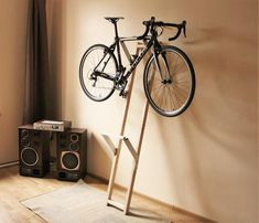Double bicycle rack Modern, double bicycle rack, lean against wall, no mounting needed, perfect for modern interior. Bicycle Storage Rack, Indoor Bike Storage, Indoor Bike Rack, Diy Bike Rack, Bike Hanger, Bicycle Rack, Bicycle Decor, Bicycle Design, Bike Storage Garage Wall