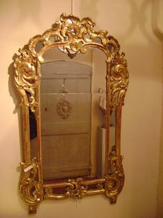 Mirror in carved and #gilt wood with #mirroded #panels. Beautiful gilding. #Regency period, 18th century. For sale on Proantic by  Antiquités Alric.